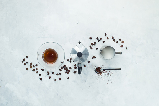 Header with coffee maker minimalist flat lay with coffee beans, milk, ground coffee and geyser... - gettyimageskorea
