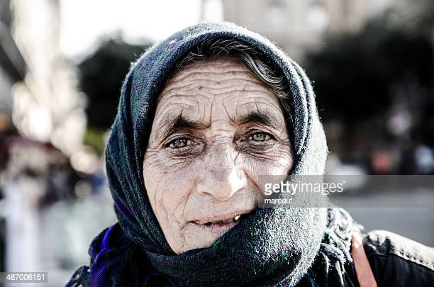 headhot of woman gipsy wearing a scarf on her head - bad teeth stock photos and pictures