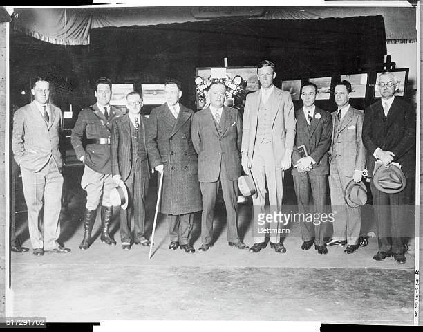 Heading a group of aviation notables, Col. Lindbergh visited Detroit's great aircraft show. Left t right B.F. Maroney, builder of Lindy's plane,...