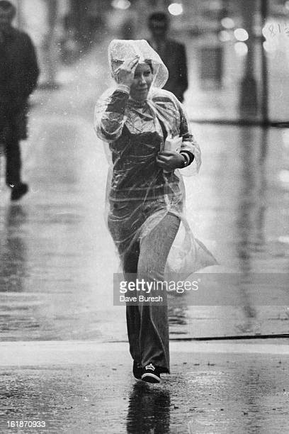 SEP 1 1972 Heading for a Drier Place A young female pedestrian hurries through Friday morning's rain in Denver trying in vain to keep dry Denver's...