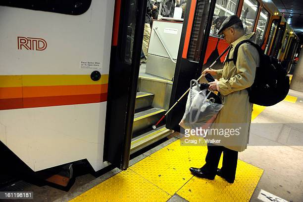 Heading home Denver Athletics Club CEO General Manager Andre van Hall boards the light rail at the Convention Center station in Denver CO Tuesday...