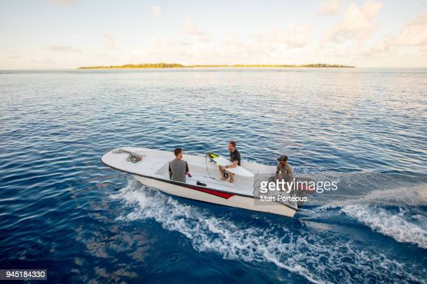 heading out to catch some waves - recreational boat stock pictures, royalty-free photos & images