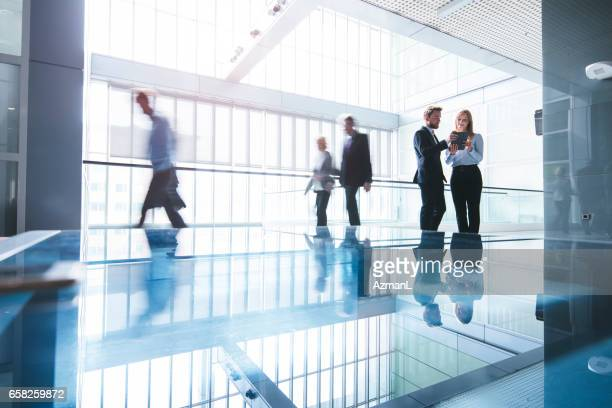 heading to another successful business day - hotel lobby stock pictures, royalty-free photos & images