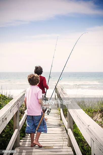 heading to do some surf fishing on the outer banks - outer banks stock pictures, royalty-free photos & images