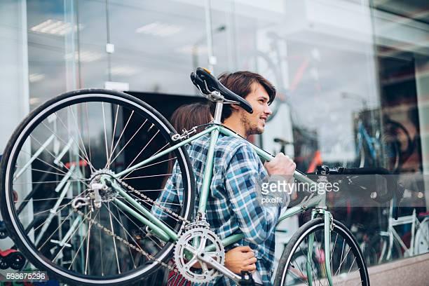 heading to the bike workshop - kaufen stock-fotos und bilder