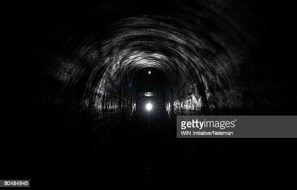 headlamp in an underground tunnel - kiew stock-fotos und bilder