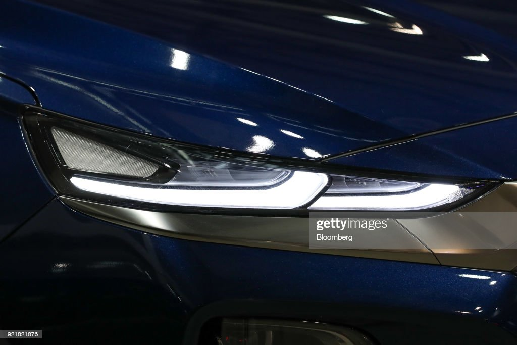 A headlamp of a Hyundai Motor Co. Santa Fe sport utility vehicle (SUV) is seen during a launch event for the updated vehicle in Goyang, South Korea, on Wednesday, Feb. 21, 2018. To recapture buyers in the U.S. who have shunned its sedans and compact cars, Hyundai has said it will bring eight new or redesigned crossovers or SUVs by 2020. Photographer: SeongJoon Cho/Bloomberg via Getty Images