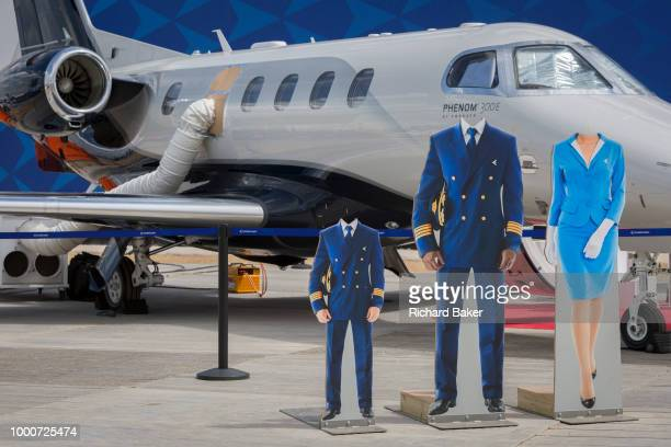 Headless cutouts for visisors at the Embraer exhibit at the Farnborough Airshow on 16th July 2018 in Farnborough England