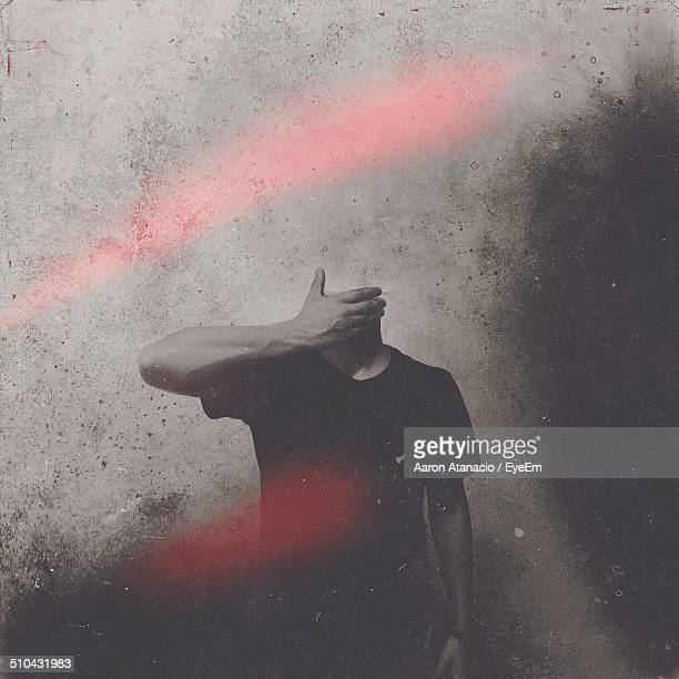 headless man standing against the wall - headless man stock pictures, royalty-free photos & images
