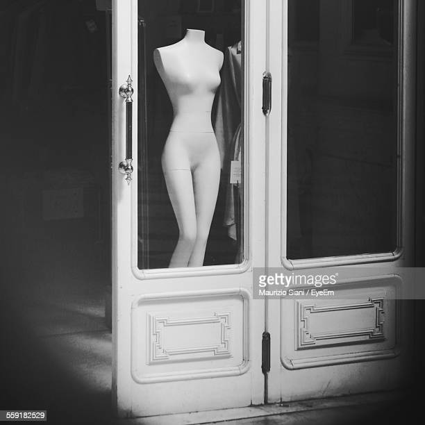 Headless Mannequin Seen From Glass Door