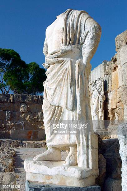 Headless statue, Roman gymnasium, Salamis, North Cyprus. Archaeologists have found remains at Salamis dating back to the 11th century BC. Evidence of...
