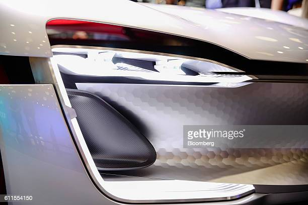 Headlight sits illuminated on a new Renault Trezor concept automobile, produced by Renault SA, during the second press day of the Paris Motor Show at...