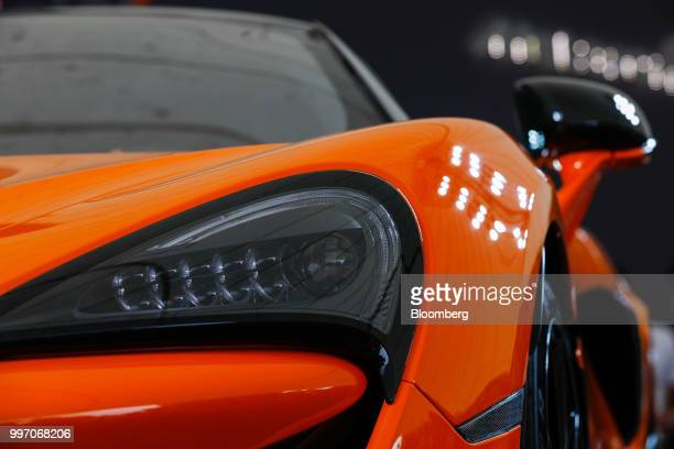 A headlight sits on the McLaren 600LT supercar manufactured by McLaren Automotive Ltd during its launch at the Goodwood Festival of Speed near...