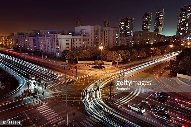 Headlight trails at a crossroads