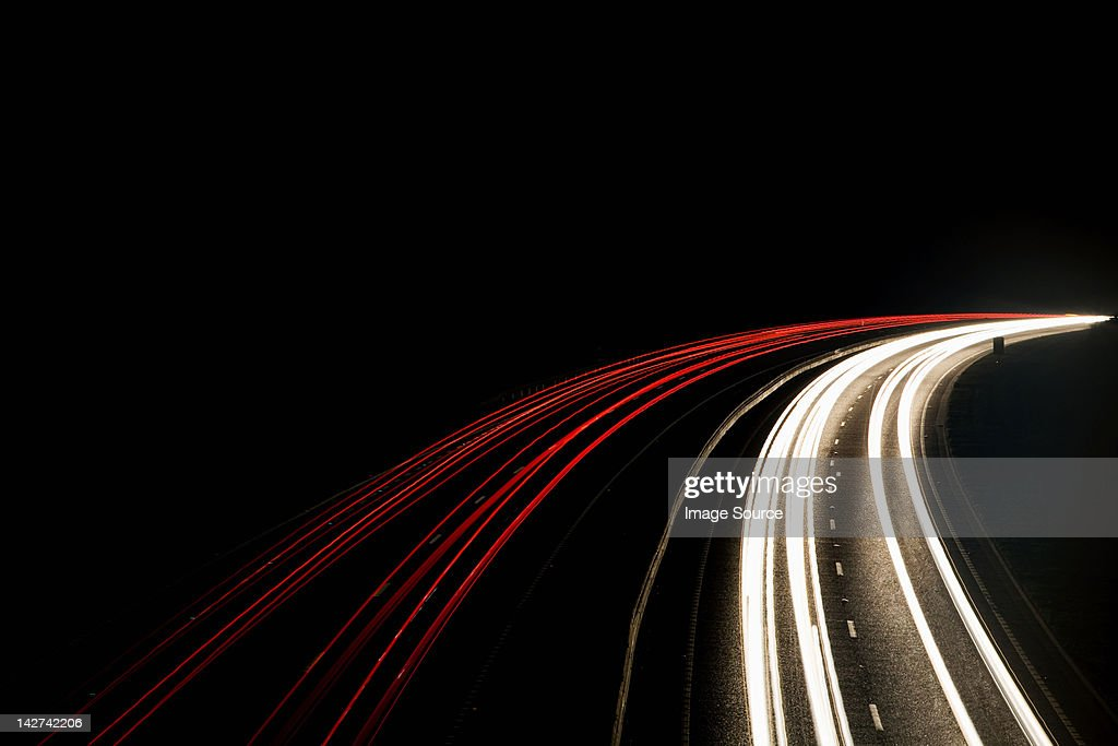 Headlights and tail lights on motorway : Stock Photo