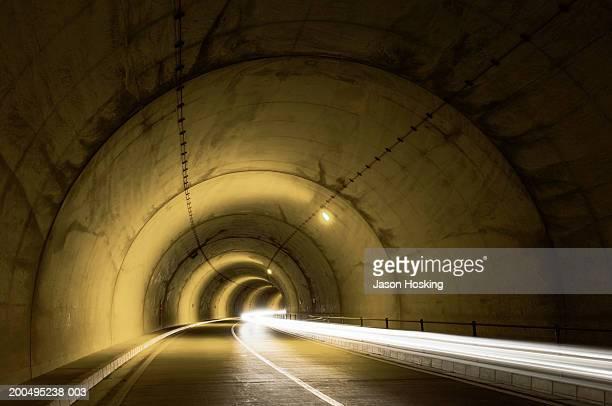 headlights inside concrete tunnel (long exposure) - 地下鉄電車 ストックフォトと画像