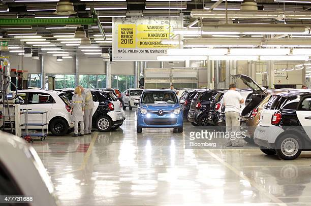 Headlights shine from a Renault Twingo automobile as it is driven off the production line at the Renault Revoz dd plant a unit of Renault SA in Novo...