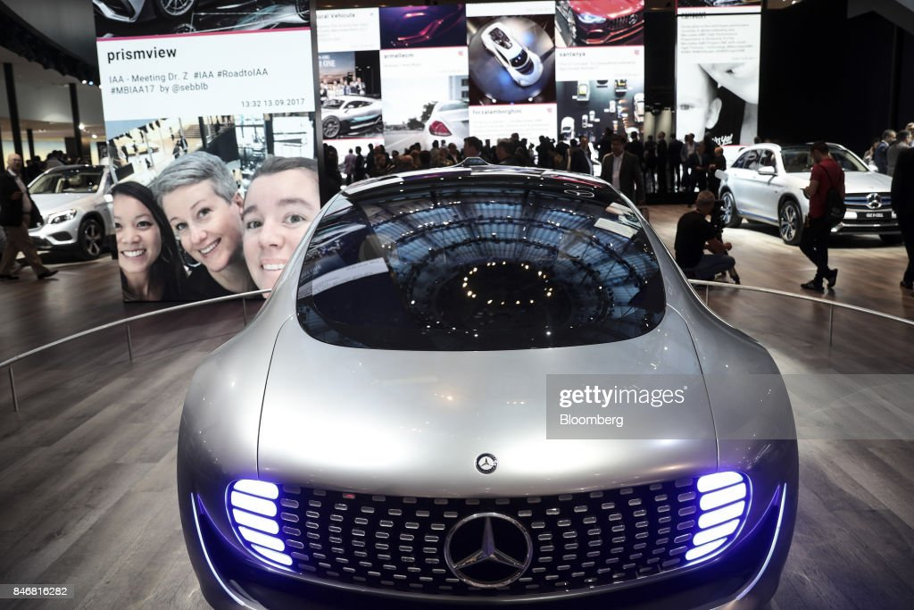 Headlights sit illuminated on a Mercedes-Benz Generation EQA electric sport-utility vehicle (SUV) as it sits on display during the second media preview day of the IAA Frankfurt Motor Show in Frankfurt, Germany, on Wednesday, Sept. 13, 2017. The 67th IAA opens to the public on Sept. 14 and features must-have vehicles and motoring technology from over 1,000 exhibitors in a space equivalent to 33 soccer fields. Photographer: Simon Dawson/Bloomberg via Getty Images