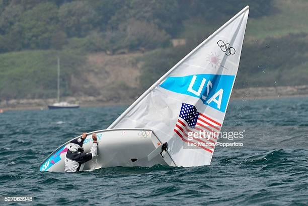 Olympics Sailing Weymouth Mens Laser Class Rob Crane USA capsizes during the fleet race