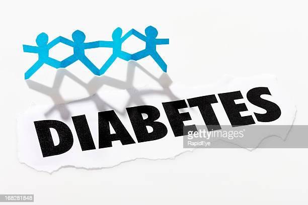 "Überschrift ""Diabetes'unter vier Papier-Kette-cut-out-Gäste"