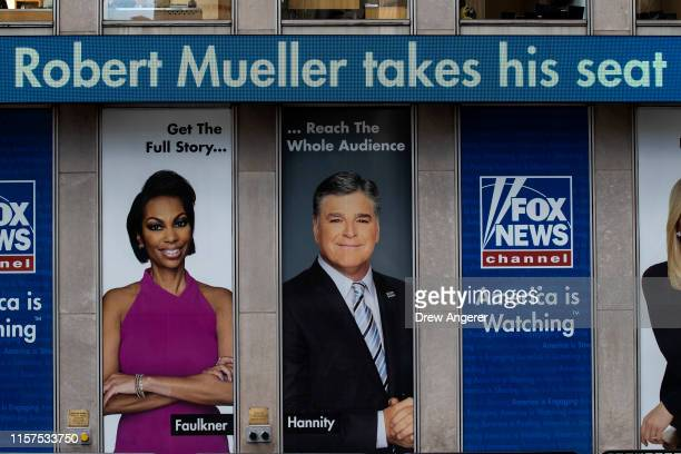Headlines about former Special Counsel Robert Mueller's testimony to Congress are displayed on the ticker outside of the Fox News headquarters on...