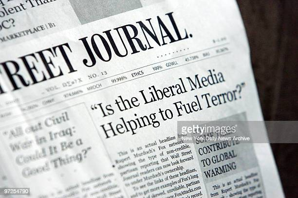 Headlines from a parody mockup of the Wall Street Journal printed by Moveonorg in response to the news that Rupert Murdoch plans to buy the paper