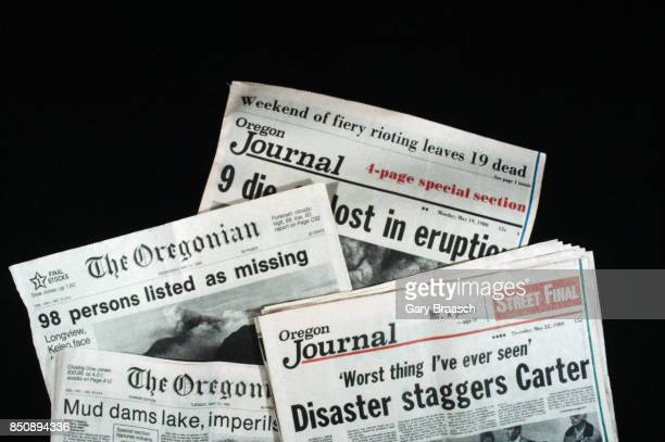 Headlines in Oregon newspapers reporting the eruption of Mount St. Helens in Washington.