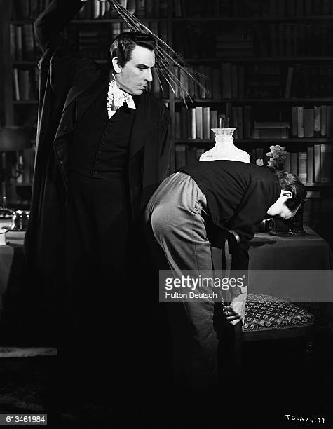 Headmaster Sir Cedric Hardwicke canes a naughty pupil in a scene from the 1940 film Tom Brown's School Days based on the novel of English public...