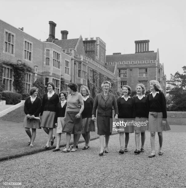 Headmistress Elizabeth Clarke pictured walking with female pupils in the grounds of Benenden School an indpendent boarding school for girls in...
