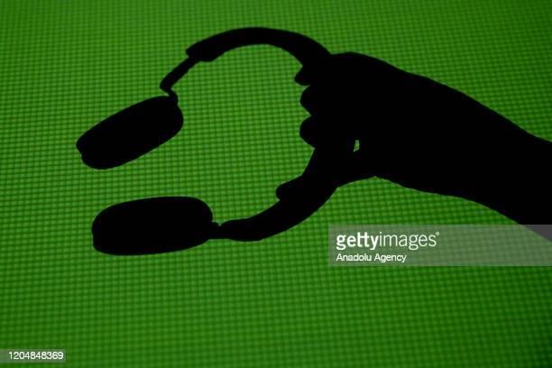 Headphone silhouette is seen in Antalya, Turkey on February 27, 2020.