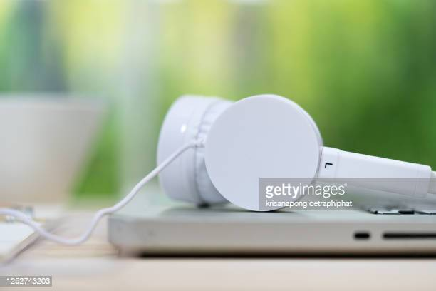 headphone with laptop on the table. - harvest icon stock pictures, royalty-free photos & images