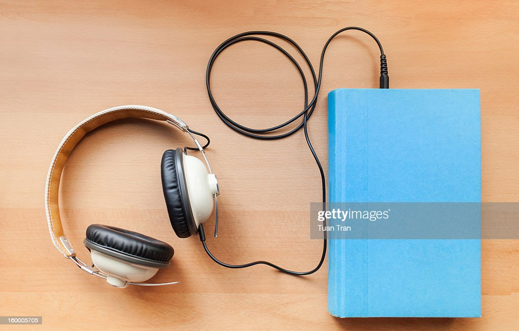 headphones and a book : Stock Photo