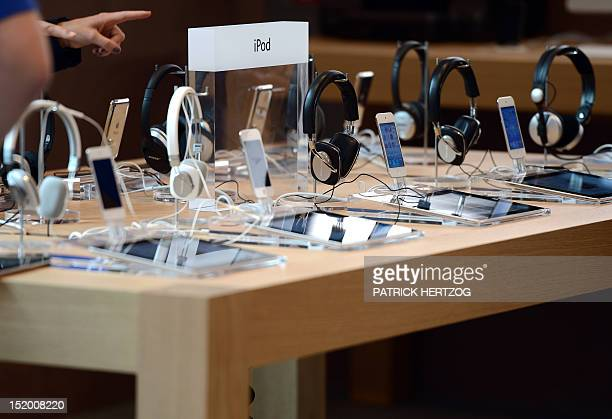 Headphones and iPods are on display during the inauguration of a new Apple store in Strasbourg eastern France on September 15 2012 AFP PHOTO /...