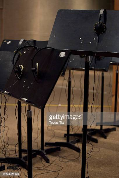 Headphones and music stands in a recording studio