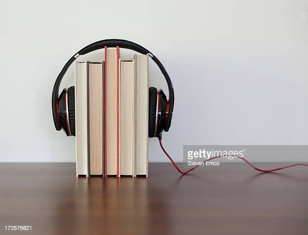 headphones around a group of books - medium group of objects stock pictures, royalty-free photos & images