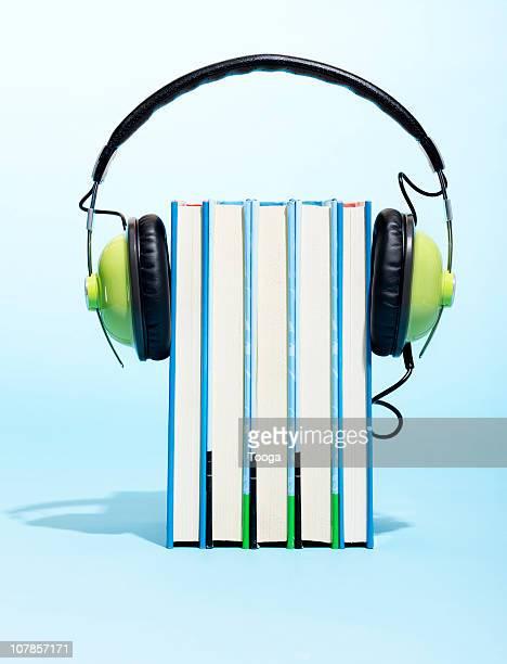 headphones around books - audio equipment stock pictures, royalty-free photos & images