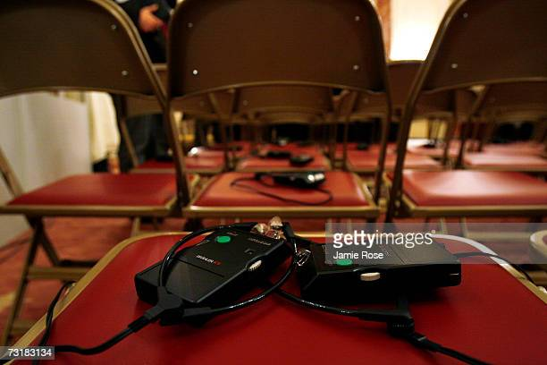 Headphones for translation purposes left by audience members sit on chairs after the conclusion of a press conference with German Foreign Minister...