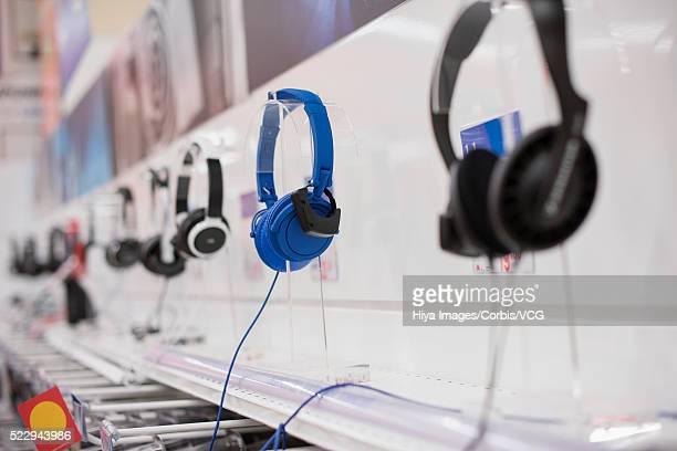 Headphones hanging in row at store display