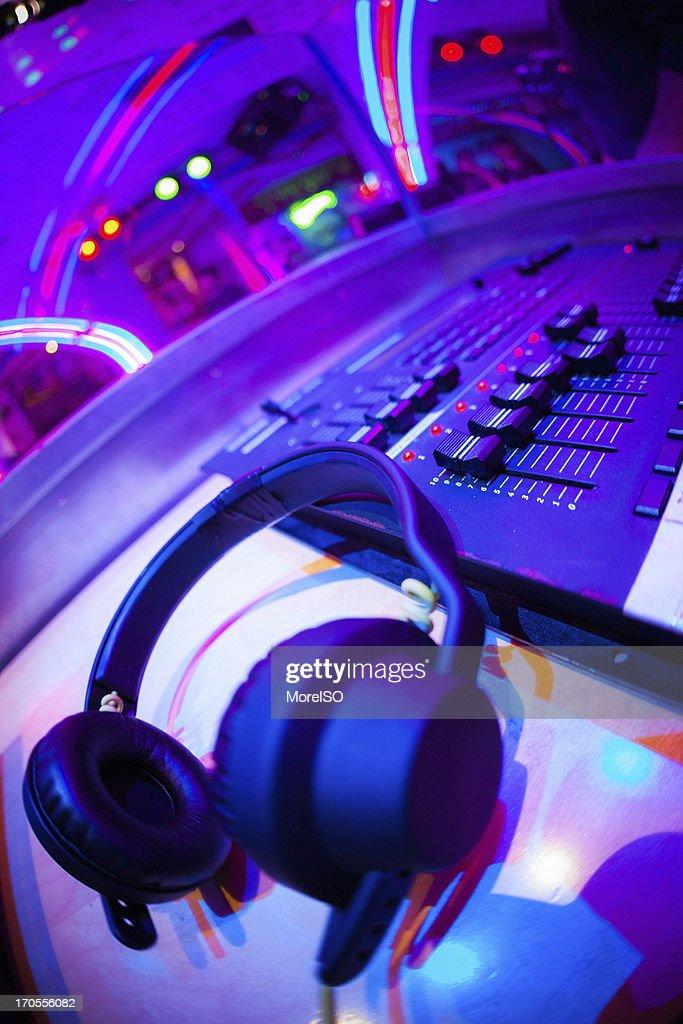 Headphones in the nightclub : Stock Photo