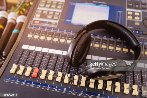 headphones, microphones, amplifying equipment, studio audio mixer knobs and faders, background sound mixer. workplace and equipment sound engineer. sound acoustic music mixing, selective focus - radio broadcasting stock pictures, royalty-free photos & images