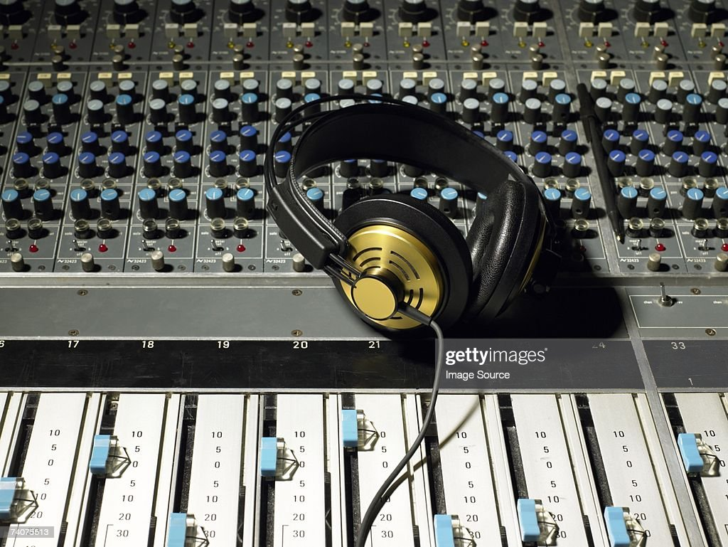 Headphones on a mixing desk : Stock Photo