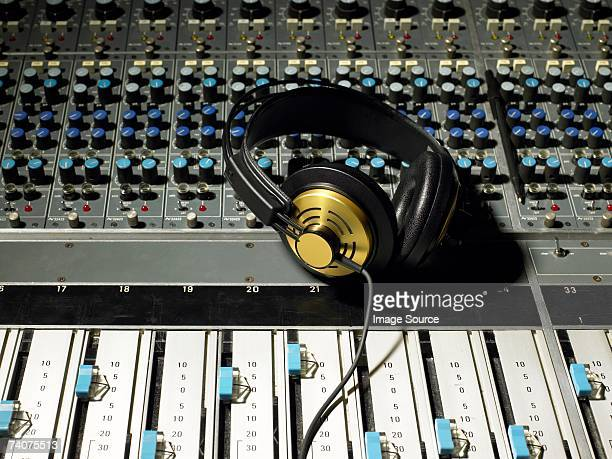 headphones on a mixing desk - equaliser stock pictures, royalty-free photos & images