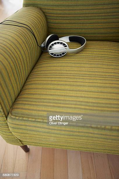 headphones on an armchair - oliver eltinger stock-fotos und bilder