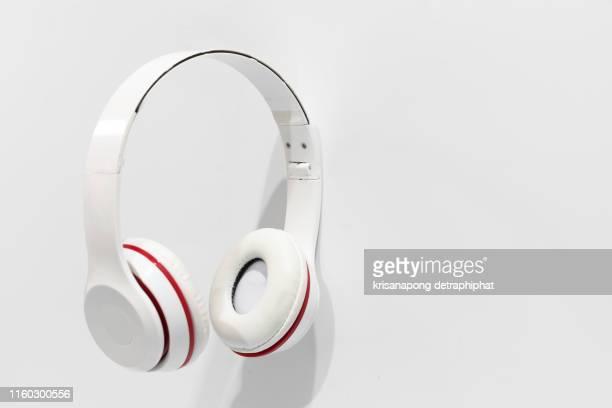 headphones on white background - casque audio photos et images de collection
