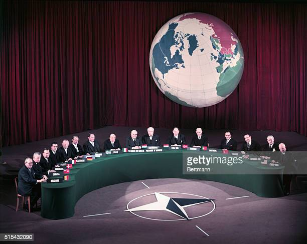 Heads of Government attending the NATO toplevel meetings here gather at the Palais de Chaillot for the annualFamily Portrait Left to right are...