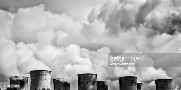 heads of power - air pollution stock pictures, royalty-free photos & images
