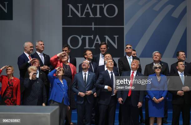 Heads of state and government including Croatian President Kolinda GrabarKitarovic Lithuanian President Dalia Grybauskaite German Chancellor Angela...