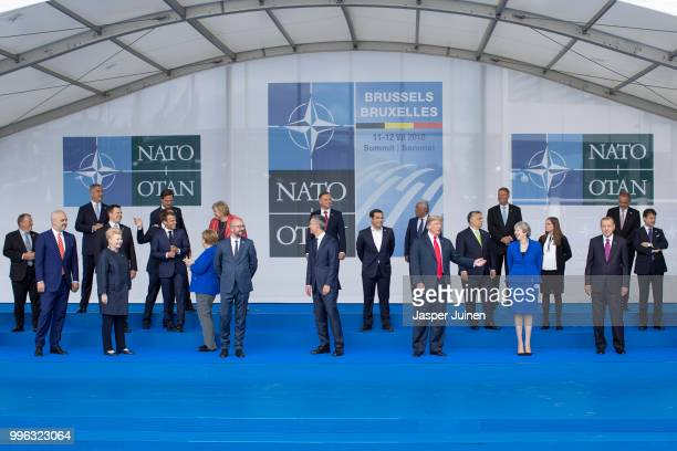 Heads of state and government including French President Emmanuel Macron German Chancellor Angela Merkel US President Donald Trump British Prime...