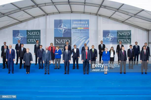 Heads of state and government including Lithuanian President Dalia Grybauskaite French President Emmanuel Macron Belgian Prime Minister Charles...