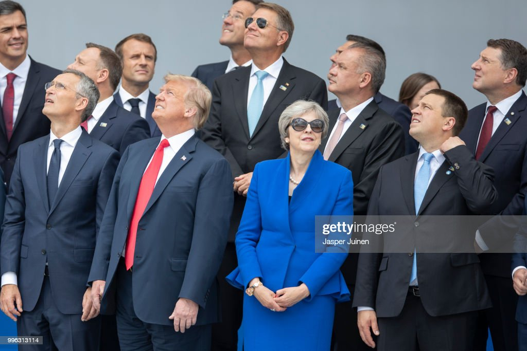 Heads of state and government, including (from L to R, first row) NATO Secretary General Jens Stoltenberg, U.S. President Donald Trump, British Prime Minister Theresa May and Estonia's Prime Minister Juri Ratas attend the opening ceremony at the 2018 NATO Summit at NATO headquarters on July 11, 2018 in Brussels, Belgium. Leaders from NATO member and partner states are meeting for a two-day summit, which is being overshadowed by strong demands by U.S. President Trump for most NATO member countries to pay more towards funding the alliance.